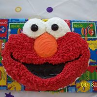 2Nd Birthday Elmo Cake Nothing fancy, but this was my first cake to ever decorate. My husband even melted the eyes off! I fixed them. I was so nervouse about...