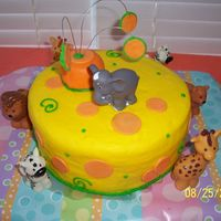Yellow With Orange Polka Dots Birthday Cake My son was having an animal party for his 2nd birthday. I used two 9 inch cakes on with buttercream in the middle. The outside is also...