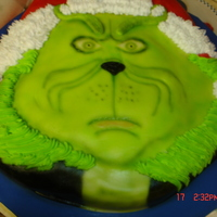 Mr Grinch Devills food with chocolate fudge frosting, butter cream and fondant. Made for my daughter's 4th grade Christmas party.