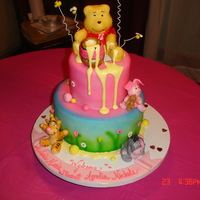 Baby Pooh And Friends White sour cream cake with white chocolate ganache fill , butter cream and fondant. Fondant and gum paste used for deco and characters.