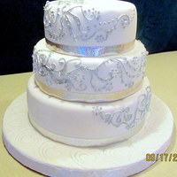 September Wedding Painted the royal icing with silver airbrush color.