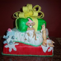 Christmas Baby I made this cake for a baby shower close to christmas, we intertwined the jungle theme with the christmas theme.