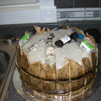 Barrel O' Booze cake is covered in BCF, Wood is MMF airbrushed, ice cubes are knox gelatin with cherry flavor and vodka. plastic mini bottles on top.