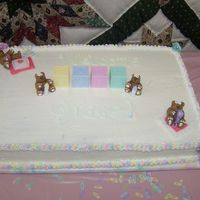 100_0261.jpg 12x18 sheet cake. half white cake and half devils food cake. The bears were done out of fondant. First time working with fondant and loved...