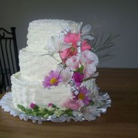100_1133.jpg 3 tier white cake iced in BC. Basket weave design with real flowers for a small wedding that was this evening.