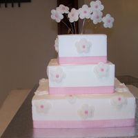 100_1123.jpg This is a three tier dummie cake. Flowers are made out of fondant.