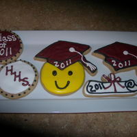 Graduation Cookies NFSC, cinnamon flavored with Antonia74 icing. I made these for my baby who graduated last week.