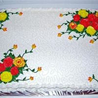 91Stbday1.jpg Birthday cake for someone celebrating their 91st birthday. wasc cake and buttercream frosting. Request was for yellow and red roses and no...