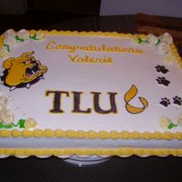 Bulldog Graduation Fondant flowers and beads with color flow college mascot and paws.