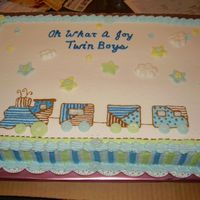Baby Train MMF fondant buttons and stars. Buttercream frosting and strips on side of cake.