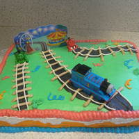 Thomas The Train Cake   All buttercream except for the trains and the picture card in the back. Made for alittle boys 4th birthday. Thanks for looking!