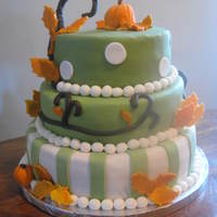 Fall/halloween Themed Cake This was my first three tiered cake. All fondant accents. Pumpkins made of RKT covered in fondant. Yellow cake with chocolate pudding. I...