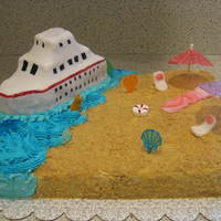 Cruise Ship/beach Theme This was fun to make! Ship is RKT with mmf, sand is crushed grahm crackers and the rest is buttercream. Two layer cake with chocolate...