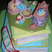 Family Story Time This cake was done for a customer's son, who loves when the family sits by the fireplace and reads books. He loves to read, and he...