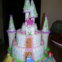 A Princess Castle Iced in butter cream, with fondant accents and plastic princess.