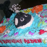 A Whale Of A Birthday Idea from the Wilton cake book, with some of my personal touches.9x13 cake, whale is the petite doll mold, tail is plastic dowel rod, iced...
