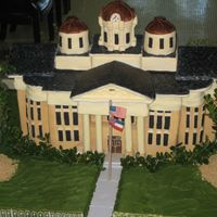 County Courthouse The roof was made of foam board and covered in fondant. The base of the cake was mostly cake and covered in fondant. The cake had to feed...