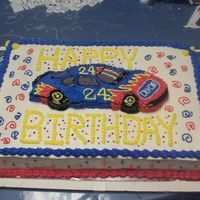 Jeff Gordon Birthday All white cake w/ vanilla pudding filling...Buttercream frosting,the car I cut out of another sheetcake and decorated by eye...VeryHappy...