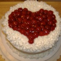 Valentine's Day Party At Church Cherry Chip cake, with Cherry Pie filling in a heart shape, with Rosettes