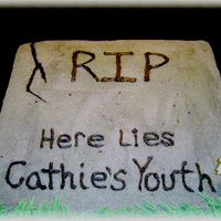 Rip Youth my sisters 40th birthday cake. huge sheet cake, icing grass and flowers, mulitiple colors of colored sugar to get a very realistic stone...