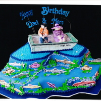 Fishing Heaven blue fondant, blue piping gel, fondant people, royal icing-boat & fish...both painted with luster dusts...they are really shiny..but...