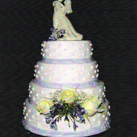 Dotted Wedding Cake  sorry about the pic, it scanned in with purple lines. It is a white cake with vanilla icing, purple icing ribbon, white polka-dots, real...