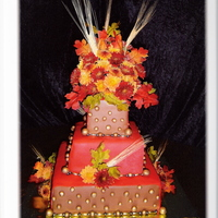 Autumn Wedding Cake This was my first time using fondant. I was totally scared !! Cake is vanilla, gold balls are fondant/airbrushed, and flowers are real,...