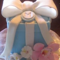 Blue Present Cake With Gumpaste Orchid And Flower Blooms