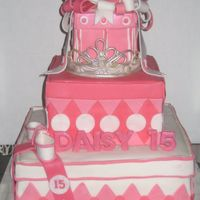 Pink Present Cake This is my first square stacked cake. The tiara sitting on the secound tier is made out of gumpaste. The entire cake is decorated woith...