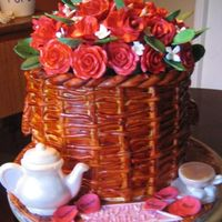 Basket Of Red Roses The roses and rose petals are made out of gumpaste. The cake is covered in fondant. The tea set is made out of a chocolate mold. I even...
