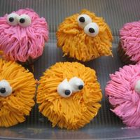 Girly Monster Cupcakes I made these for my birthday this weekend. I forgot to take a picture of them before I packed them into a container. A couple of them...