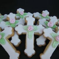 Christening Cross Cookies I made a couple dozen cross cookies for my new niece's christening tomorrow. NFSC with fondant and Duff style roses.