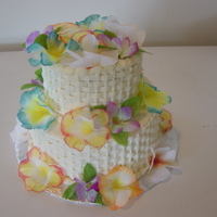 Hawaiian Themed Cake   buttercream cake w/ silk flowers
