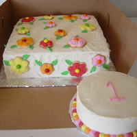 1St Birthday Cake buttercream cake w/ sugar cookie and skittle flowers