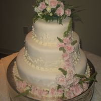 My First Wedding Cake My very first wedding cake! Almond/ Vanilla cake with Bavarian Creme filling covered in MMF! All from recipes shared on this site. It was...