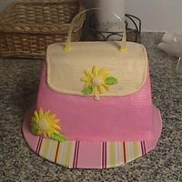 Purse Cake Here is a Purse cake, the customer wanted something girlie for another lady, the lady has 5 boys! I hope this is what she wanted!!!