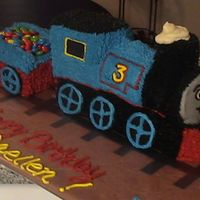 Thomas The Train Thomas the Train cake. I used the Wilton train pan, white cake and buttercream icing.