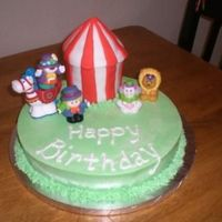 "Circus Little People Cake The birthday girls love Little People. Mother suggested we just put the toys on the cake so I made it personal by making ""Little..."