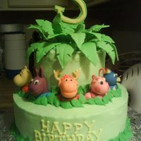 Backyardigans Cake Based off of adarabia's Zoo cake...just Backyardigans style. BC with fondant figures. I used candy melts to position the leaves.