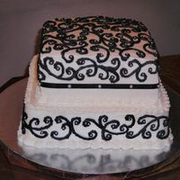 Black & White Wedding Cake Black and white wedding cake. White with black decoration and silver balls.