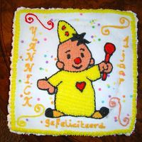 Bumba The Clown cake filled with preservers and buttercream.
