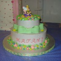 "Tinkerbell Cake 10"" and 6"" vanilla and chocolate cakes with Marshmallowcream Buttercream icing. Icing flowers and fondant bow."