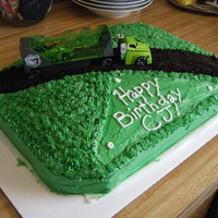 Big Truckin  Cake I did for my nephew's 2nd birthday last year. Started to run out of icing so I finished it off with a smooth surface. Everyone...