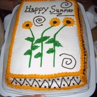 Sunflowers  This was the second cake I did for class I was taking at the college. We only did ther flowers and the border at the bottom and I added the...