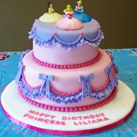 Princess Cake DIL said to design Lily's cake around the Disney princess toppers. Cake is WASC, white chocolate ganache, MFF fondant. First time for...