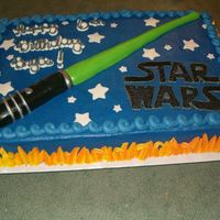 Star Wars Light Saber This is a 12x18 sheet cake frosted in buttercream with a MMF light saber and stars and buttercream fire. I got the idea for the light saber...