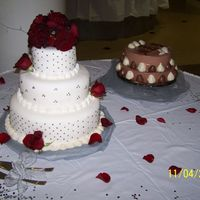 Wedding Cake 2   Another shot of my first wedding cake. It also shows the grooms cake which was strawberry shortcake covered with chocolate mousse.