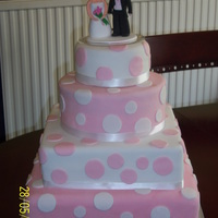 Pink And White Wedding Cake The bride wanted square and round cakes also pink and white, bottom tier is fruit, second is chocolate and the rest was vanilla. I made the...