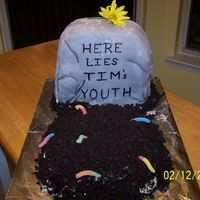 Death Of Youth Made this for a 40th birthday of a friend at work. Inspired by several on CC. Tombstone and grave are both cake. Tombstone is covered in...