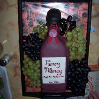 "Wine Bottle Birthday Inspired by Nunuk's Wine bottle cake. All MMF, except ribbon. Fresh red and green grapes. Made during a time crunch so not as ""..."
